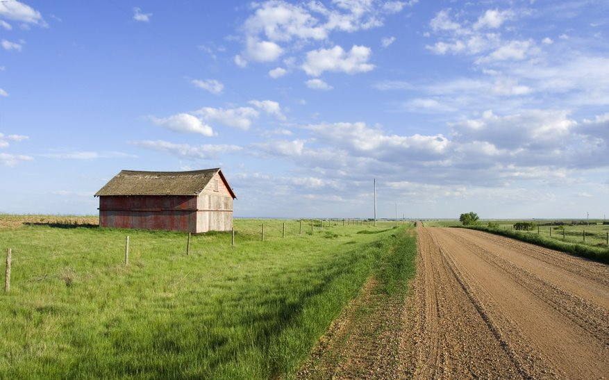Farmers shed in the fields along side a gravel road